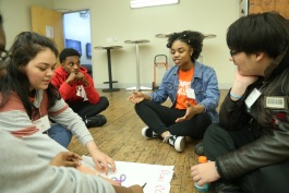 Junior Challengers are seen participating in a team building activity at their November 2018 workshop centered around what it means to be politically engaged as a teen in their community. (Submitted)