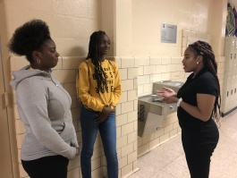 Flying Falcon staff writer Leah Boone-Stewart (R) interviews Lanaya Hamilton (L) and Bionica Barnes for an article. (Flying Falcon)