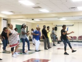 Instructor Roxie Jones leads an energetic group of line dancers at the Hickory Hill Community Center's senior line dancing class. (AJ Dugger III)