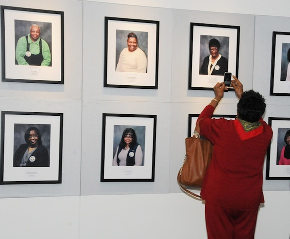 Portraits of breast cancer survivors line the walls at the Live! Just as We Are exhibit