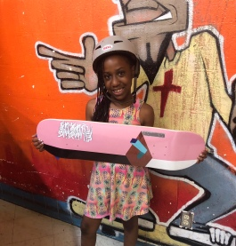 Madison Taper, winner of the girls' ages 8 to 15 division, shows off her new Fluxus skateboard. Fluxus boards are made in Memphis and are designed by local artists. (Shelda Edwards)