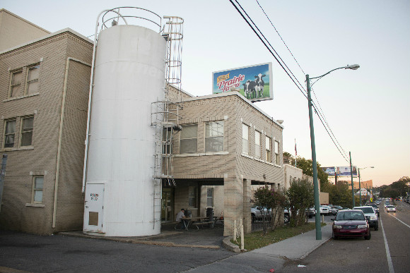 The longstanding Turner Dairy detracts from property values and redevelopment opportunities, some adjacent property owners say.
