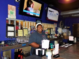 Owner and chef Octavia Young behind the counter at Midtown Crossing Grill.