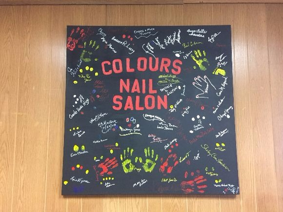 "The owner of Colours the Nail Salon calls the interior artwork a ""collage of unity"". (Sarah Jones)"