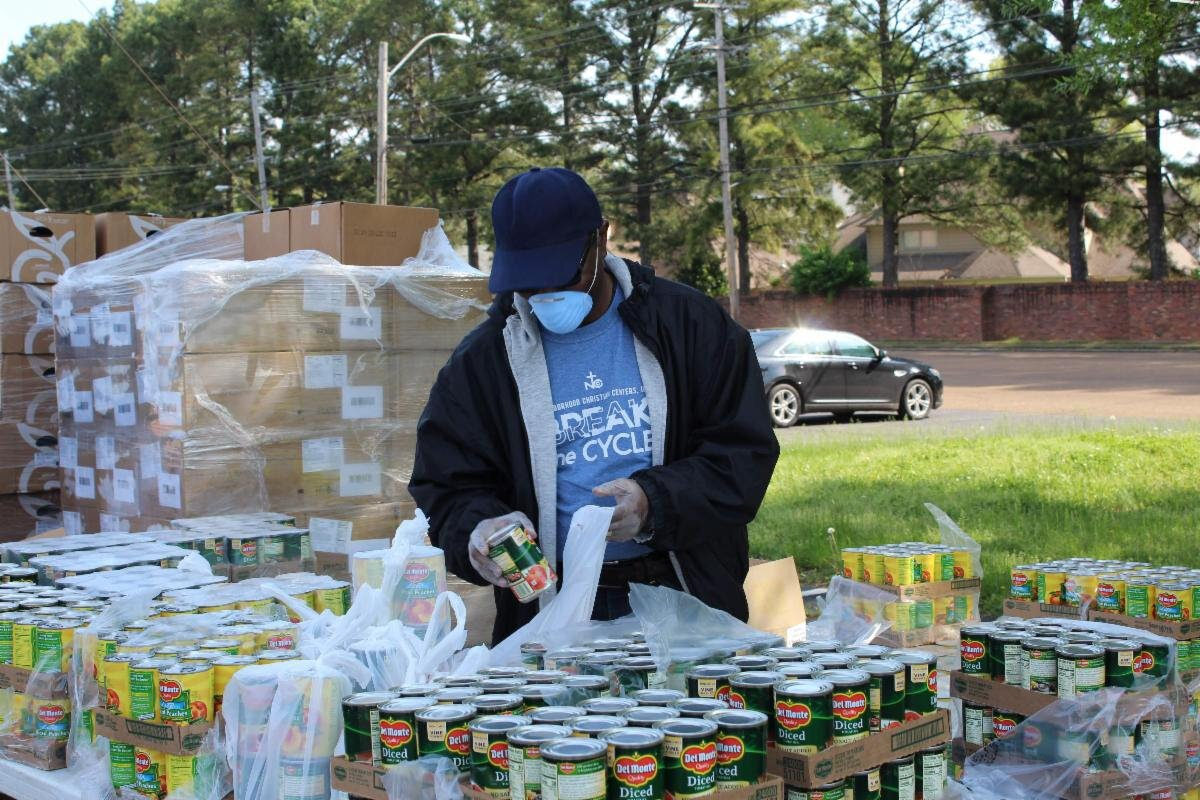 A Neighborhood Christian Center volunteer preps meals for families in response to Covid-19. (Submitted)
