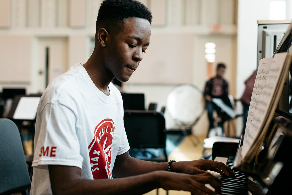 Sidney Robinson plays piano at the Stax Music Academy, a local organization supported by the National Endowment for the Arts.
