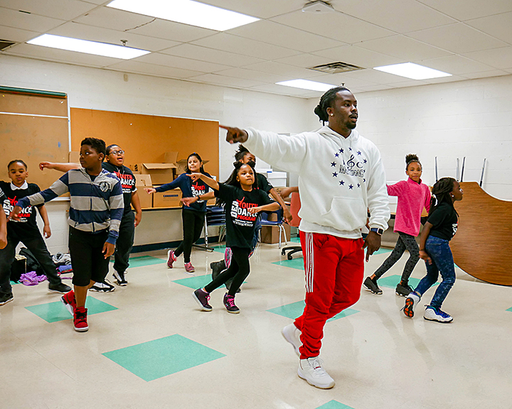 Travis Butler, New Ballet Ensemble dance instructor, works with students at LaRose Elementary. Dance classes at LaRose are held either early in the school day or the last period of the day. (Submitted)
