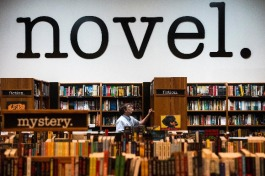 Employee Scott Graves shelves books at Novel bookstore in East Memphis. (Brandon Dill/High Ground News)