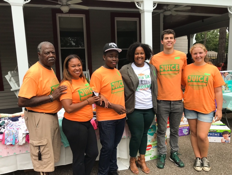 The board of JUICE Orange Mound including Kenya Moore (2nd from left) and Britney Thornton (4th from left) poses for a picture outside of The House. (Cole Bradley)