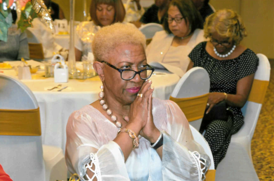 A guest looks on at performers and speakers at the Orange Mound Progressive Club's centennial celebration in September 2019. (Submitted, Tyrone P. Easley)