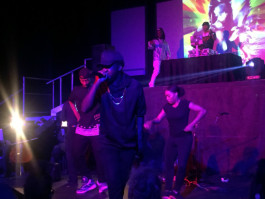 Local hip hop artist Marco Pavé performs at Midtown Opera Festival, flanked by backup dancers, DJs and instrumentalists