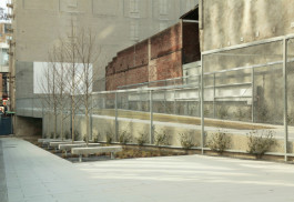 The Madison Avenue pocket park contains greenspace, gallery space, a stage and a screen for projecting films.