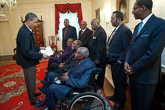 President Barack Obama talks with participants from the 1968 Memphis sanitation strike during a meeting in the White House on April 29, 2011.