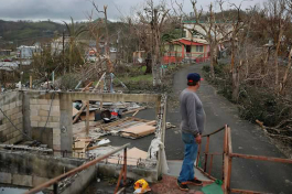 A resident looks on the devastation wrought by Hurricane Maria in Coamo, Puerto Rico.