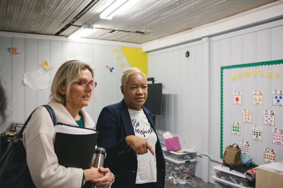 Katy Spurlock, program director with Urban Child Institute (L) and Refugee Empowerment Program director Camela Echols (R) tour the Binghampton facility. (Averell Mondie)