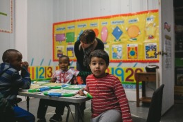 Refugee Empowerment Program volunteers work with children in the Pre-K class. (Averell Mondie)