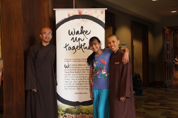 Brother Phap Nang and Sister Khai Nghiem with a practitioner at the Rhodes Day of Mindfulness.