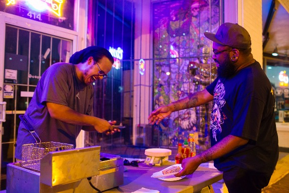 Rico Fields serves a line of hungry concert-goers during Soul Roll Saturdays at the Hi-Tone Cafe.