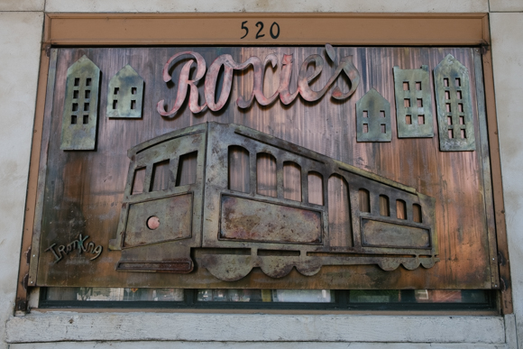 The ironwork sign at Roxie's depicts the Main Street trolleys  (Brandon Dahlberg)