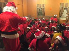 Santa visits Orange Mound Outreach Ministries in 2016 during the nonprofit's annual holiday party.