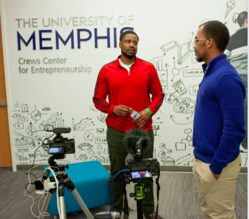James Brown, a senior at Whitehaven High, interviews Tony Knox with Memphis-based Fitnexx.