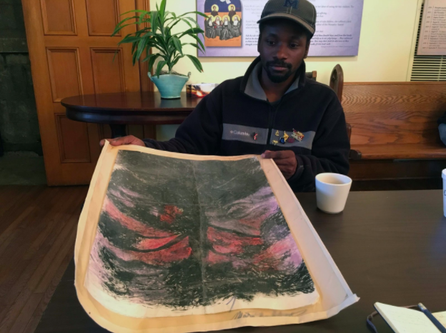 Marcus Mitchell, 35, with his drawing The Dark World at one of the weekly art classes at St. Mary's Episcopal Church.
