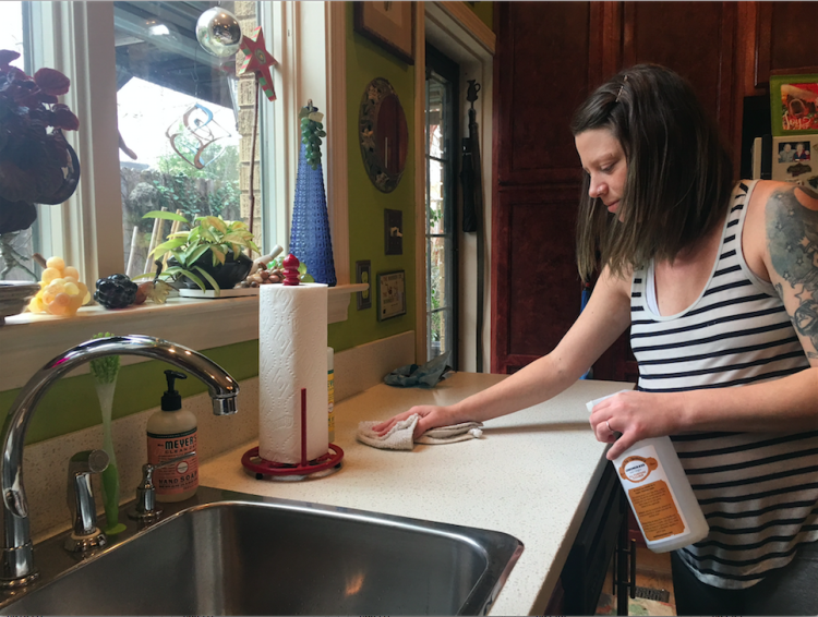 Owner Carla Worth cleans a client's house using her homemade products.