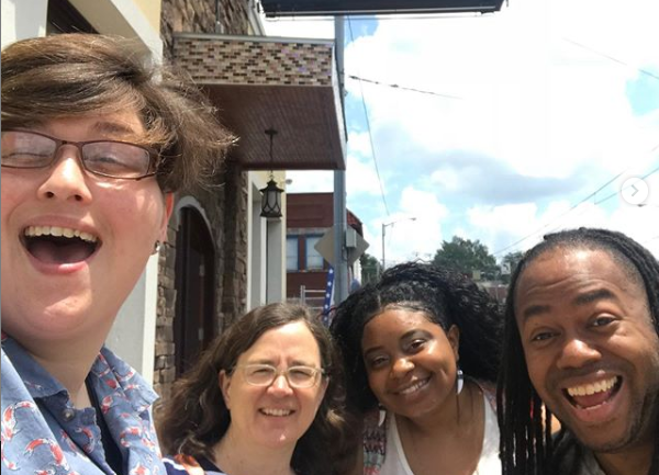 A selfie marks High Ground's first team lunch with its newest member, On the Ground Lead Writer A.J. Dugger. L to R: Cole Bradley (managing editor), Emily Trenholm (engagement manager/publisher), Deshae Dugger (wife of A.J. Dugger) and A.J. Dugger.