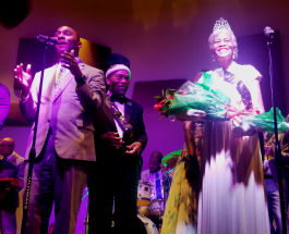 Shelby County Mayor Lee Harris (L) presents the Senior Prom's 2019 Prom Queen Everlena Yarborough. Prom King Clarence Christian watches with pride. (Baris Gursakal)