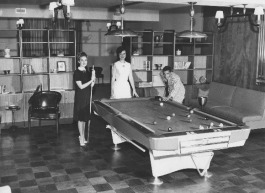 Elizabeth Frey, Marilyn Trigg, and John Maurer of the Dorcas Society of St. Peter's Catholic Church play pool at the underground bomb shelter. (University of Memphis special collections)