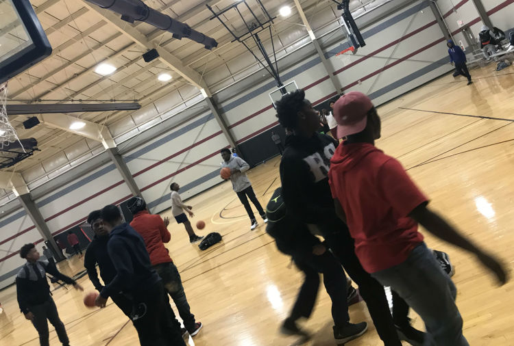 Youth play basketball at the STREETS Ministries Graham Heights location. (Dawn Neuses)