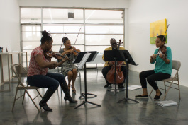 Members of the PRIZM Chamber Orchestra play as a string quartet during a meet and greet at Orange Mound Gallery on November 3. (From left to right: Chala Yancy, violin; Tami Hughes, violin; Derek Menchan, cello; and Dana Kelley, viola.