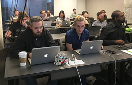 Brad Montgomery, local software developer, teaches the Tech901 Code 1.0 class, where students learn coding languages for front end and back end development. (Kim Coleman)
