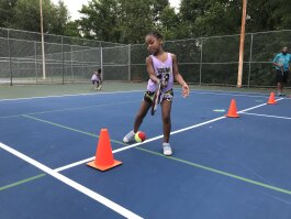 Aylah Sanders participates in a tennis skills drill during Tennis Memphis' Family Play Day, held on August 3 at the city's municipal tennis centers. (Tennis Memphis)