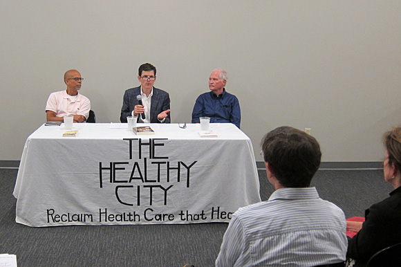 Dr. Clarence Davis (left), Dr. Jim Bailey and Dr. G. Scott Morris spoke about health care reform at the first Healthy City Town Hall meeting held at Novel bookstore on Sep. 16.
