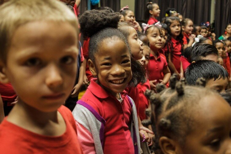 Treadwell Elementary kindergarten students beamed with excitement as they prepared to sing '¿Que ves alli?' at the school's Hispanic Heritage Day celebration. (Renier Otto)