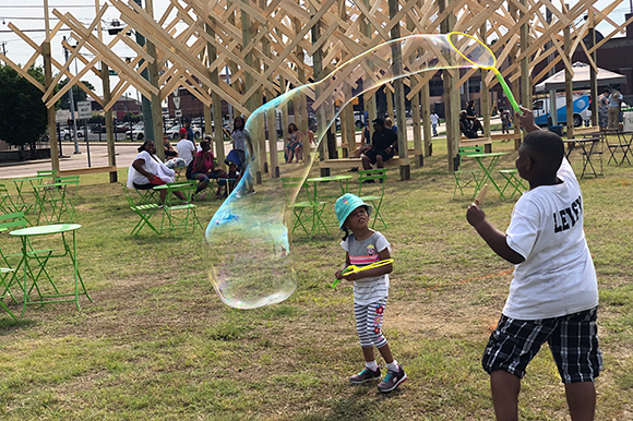 Neighborhood children played games and made giant bubbles at the June 2nd kickoff event.