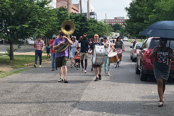 The Mighty Souls Brass Band led a second line parade through Uptown to kickoff the Treedom Memphis festivities.