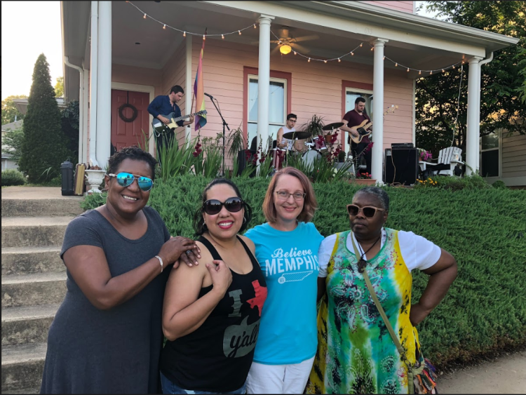 The leaders of the Uptown Community Association pose for a picture at the first porch series concert. L to R: Tanja Mitchell, Rebecca Garcia, Kaleigh Donnelly, and Njeri Fombi. (Cole Bradley)