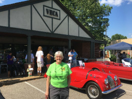 VECA board member Marci Hendrix greets visitors as they arrive at the inaugural VECA Street Faire.