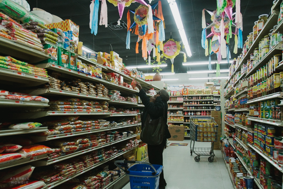A shopper at Viet Hoa Food Market on Cleveland Street in the Madison Heights neighborhood. (Averell Mondie)