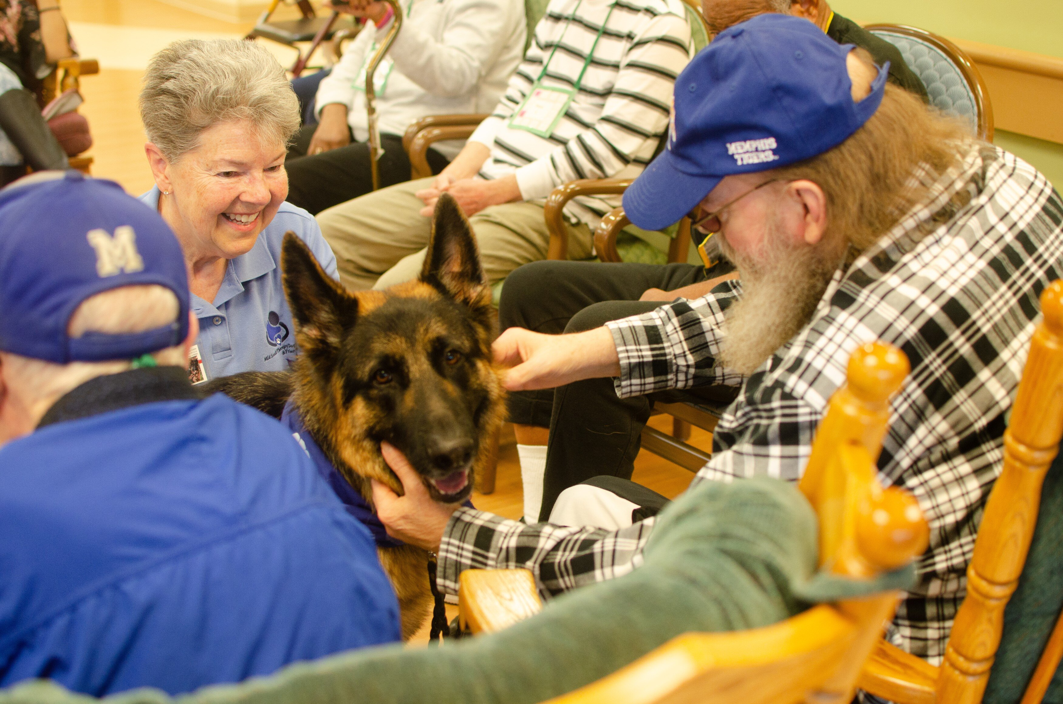 Handler San Chambers and therapy dog Batman are favorite regular visitors at Dorothy's Place. The day house is operated by  Alzheimer's and Dementia Services of Memphis, Inc. (Cat Evans)